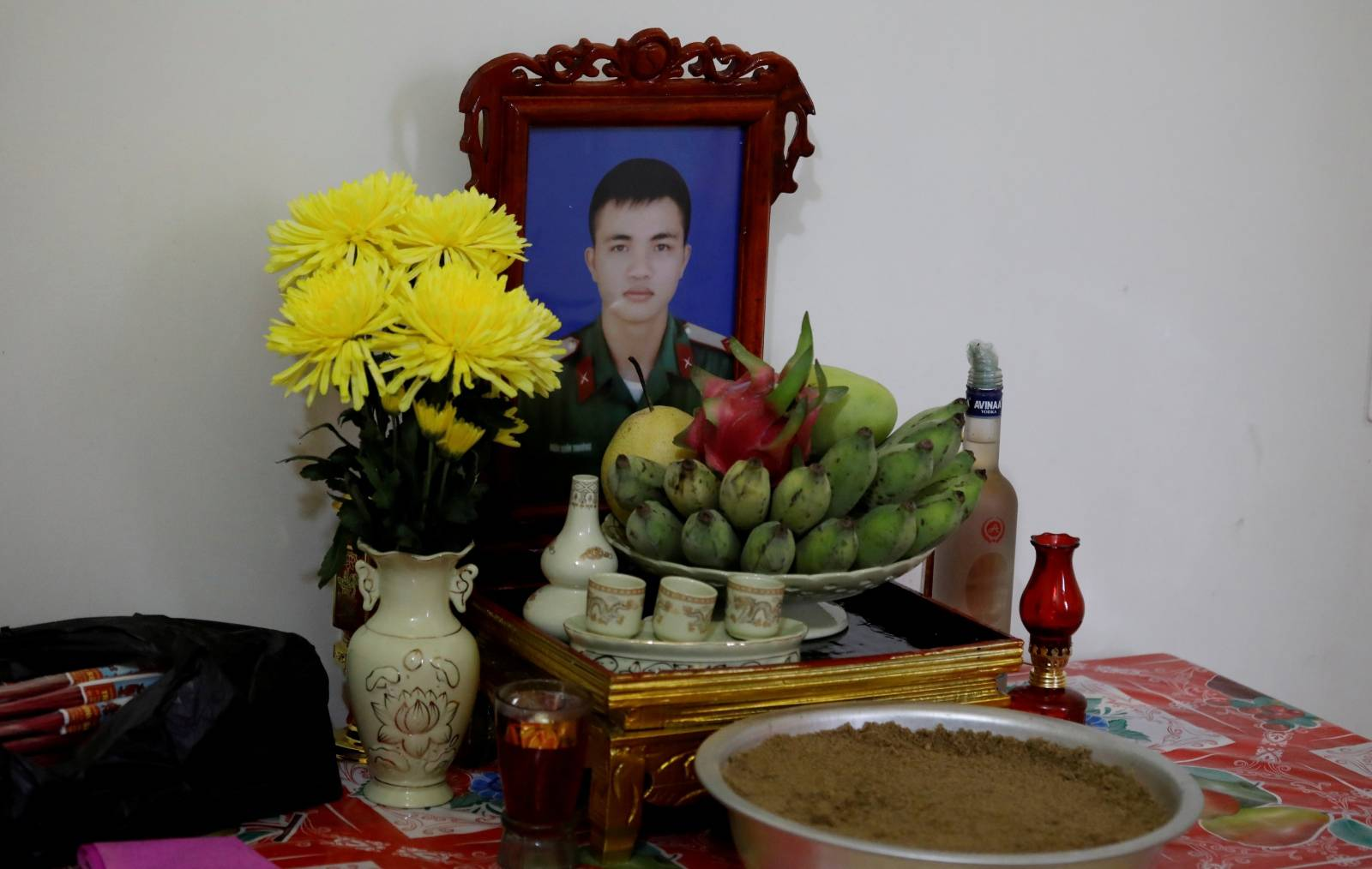 An image of Nguyen Dinh Tu, a Vietnamese suspected to be among dead victims found in a lorry in Britain, is seen at a table at his home in Nghe An province