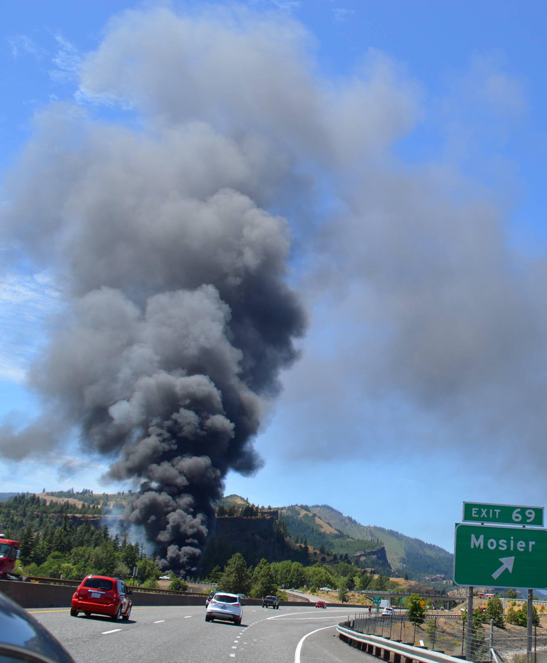 Handout photo of smoke billowing from a derailed oil train near Mosier, Oregon