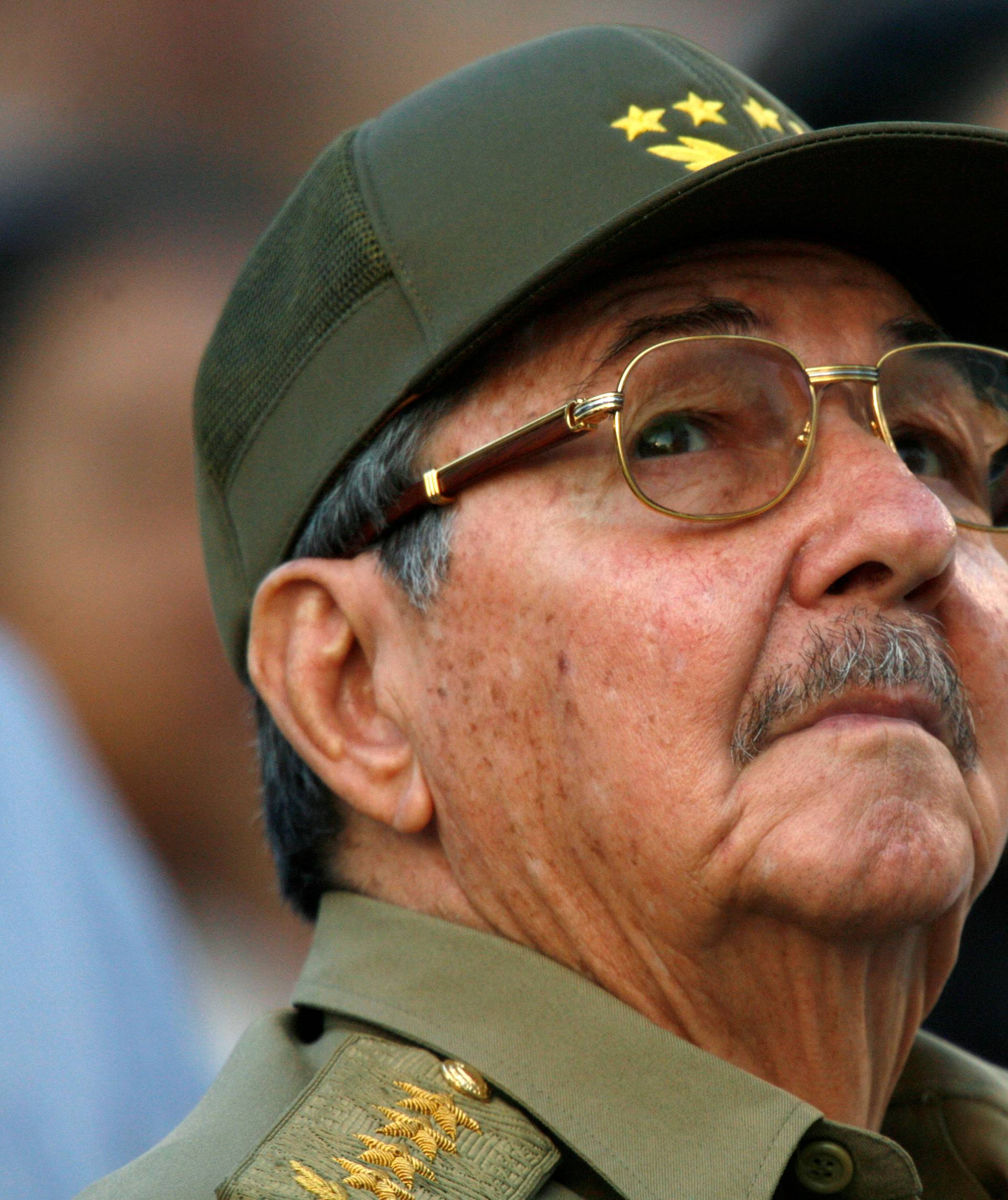 FILE PHOTO - Raul Castro looks up during an event in celebration of the 50th anniversary of the assault of the presidential palace during the regime of Fulgencio Batista, in Havana