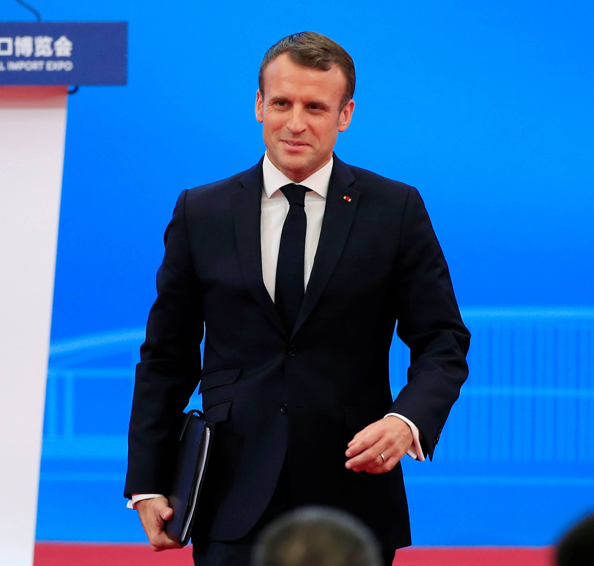 French President Emmanuel Macron returns to his seat following his speech at the opening ceremony of the second China International Import Expo (CIIE) in Shanghai