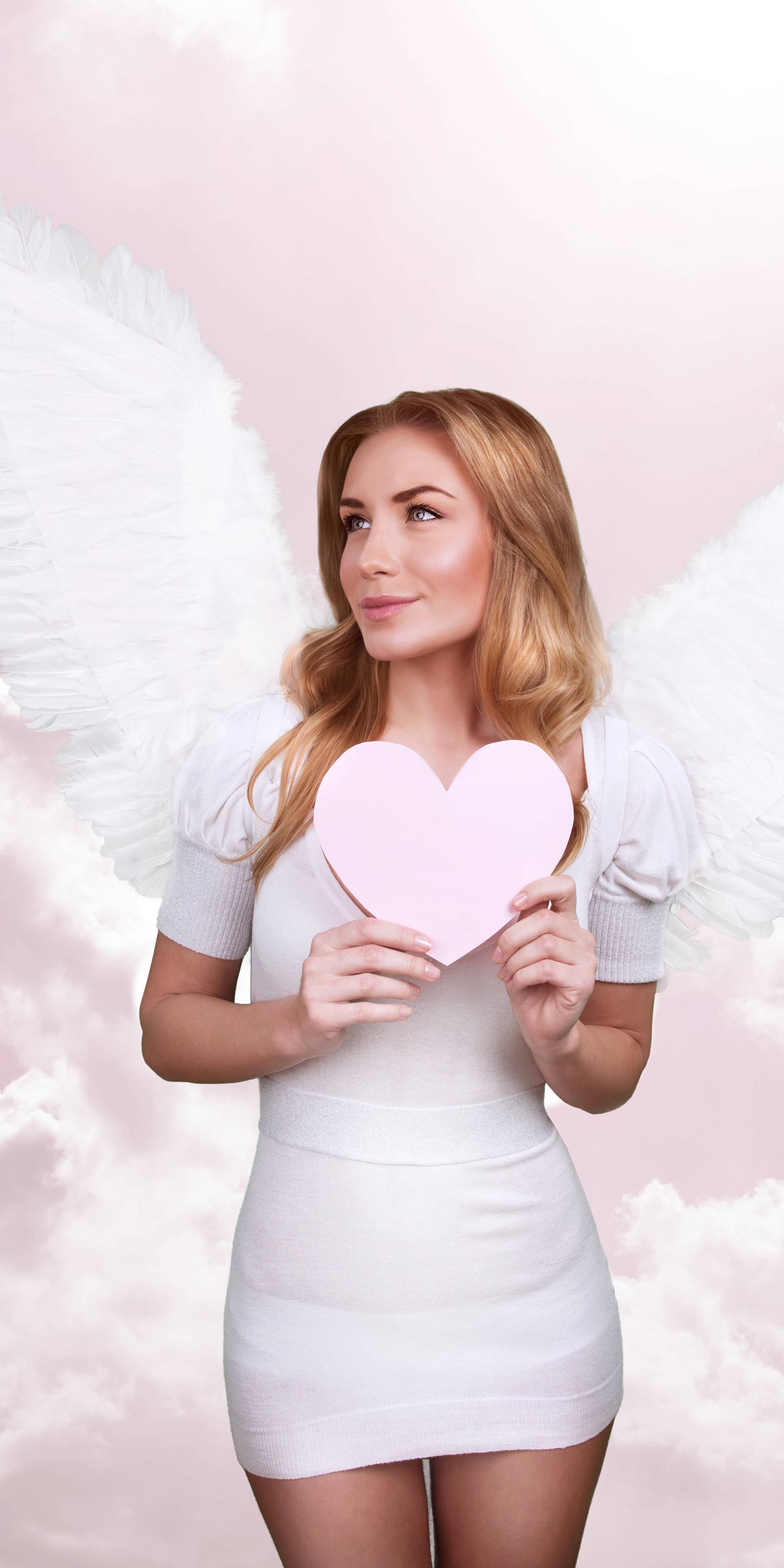 Angel of love, beautiful girl with great white feather wings in