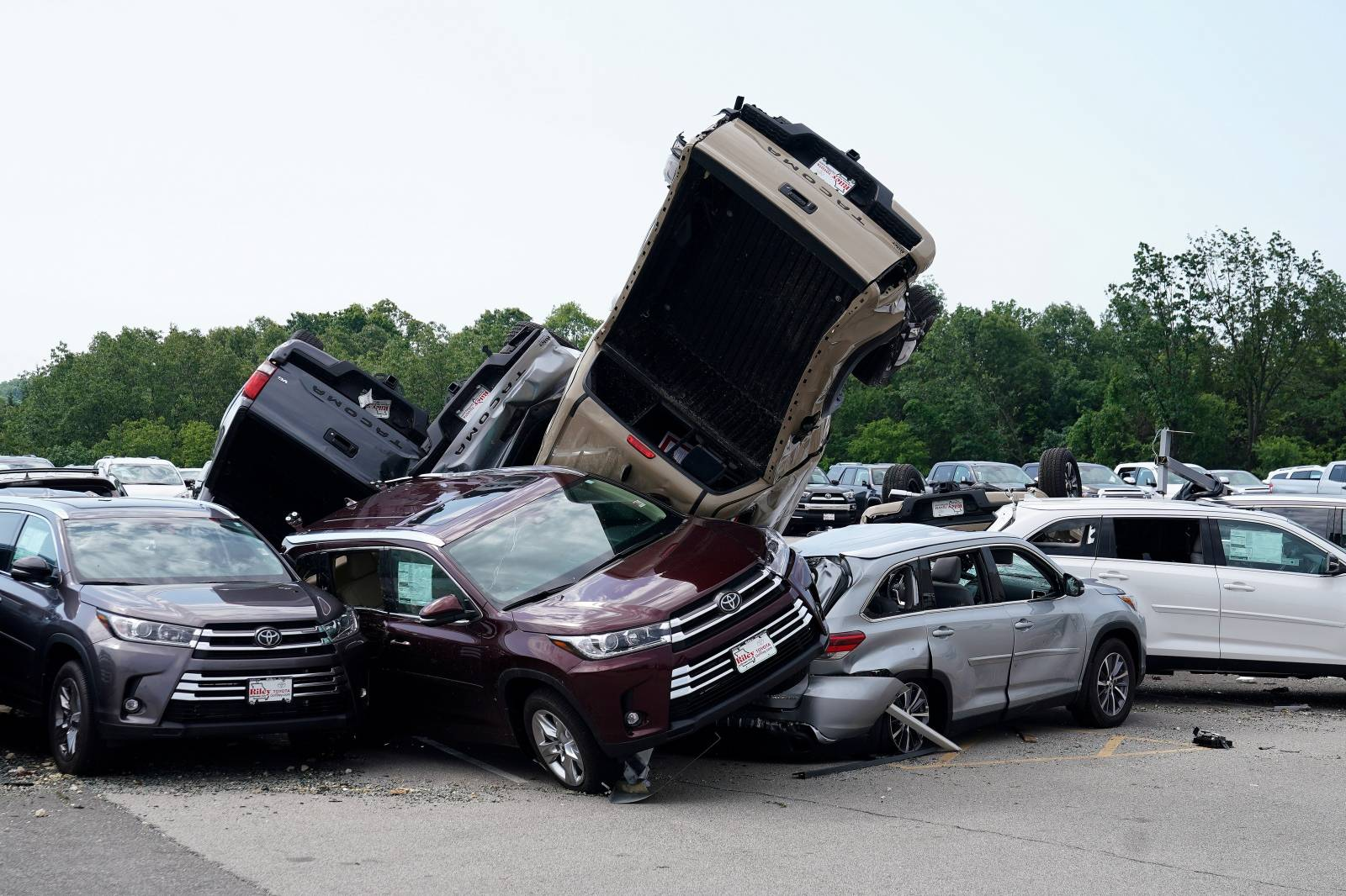 FILE PHOTO: Wrecked vehicles are pictured at a Toyota dealer following a tornado in Jefferson City