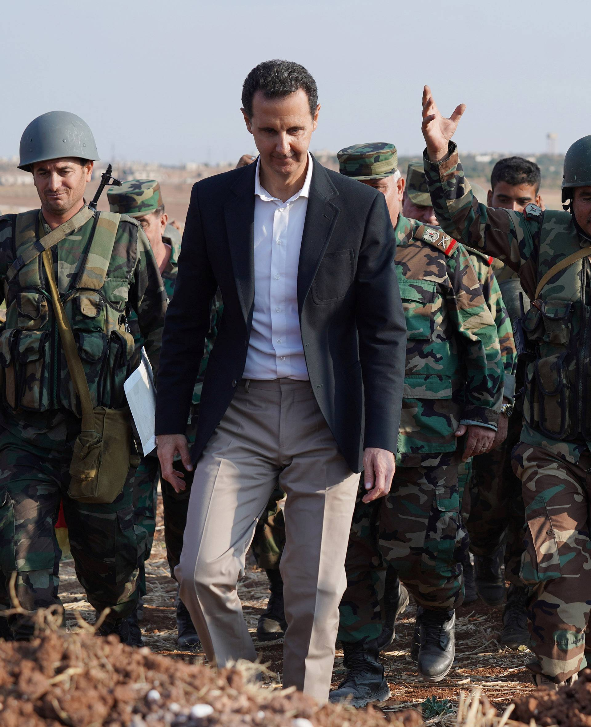 Syrian President Bashar al Assad visits Syrian army troops in war-torn northwestern Idlib province
