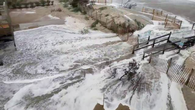 Waves are seen coming ashore in Avon