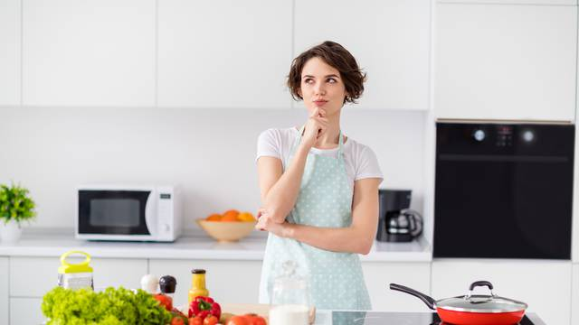 Photo,Of,Beautiful,Housewife,Holding,Arm,On,Chin,Remind,Recipe