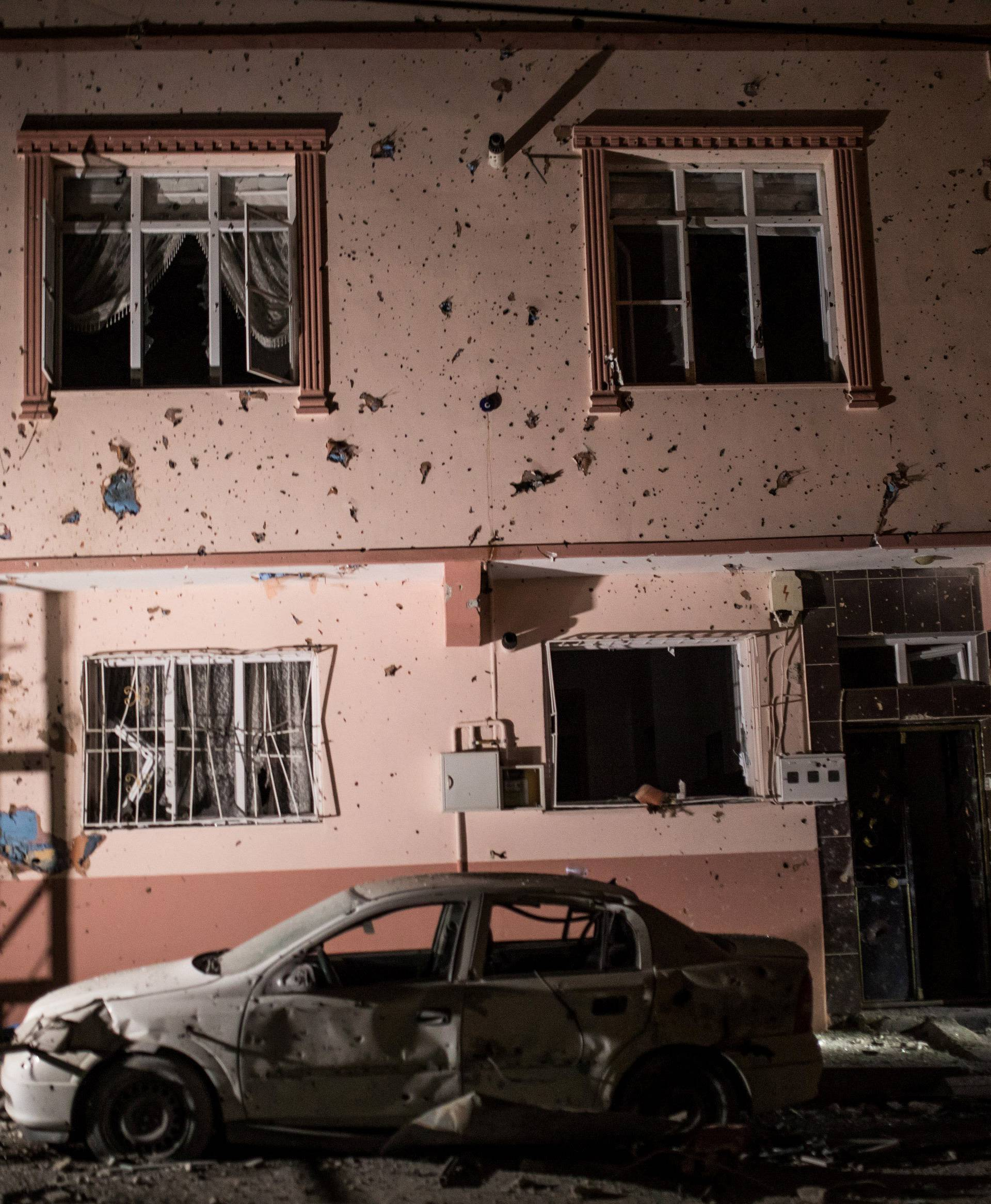 A building which was hit by rockets fired from Syria, is seen in the Turkish border town of Kilis