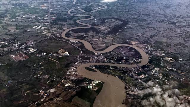 The Chao Phraya river is seen from a landing airplane in Bangkok
