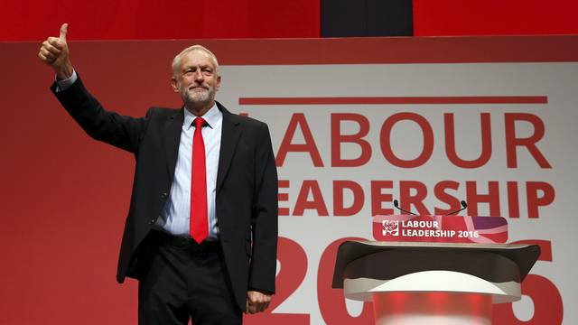 The leader of Britain's opposition Labour Party, Jeremy Corbyn, reacts after the announcement of his victory in the party's leadership election, in Liverpool