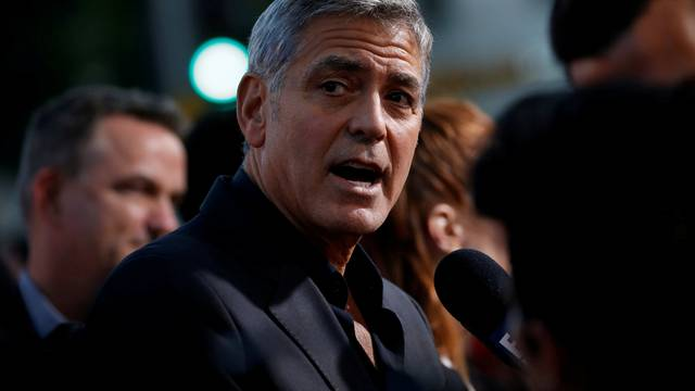 """FILE PHOTO: Director Clooney is interviewed at the premiere for """"Suburbicon"""" in Los Angeles"""