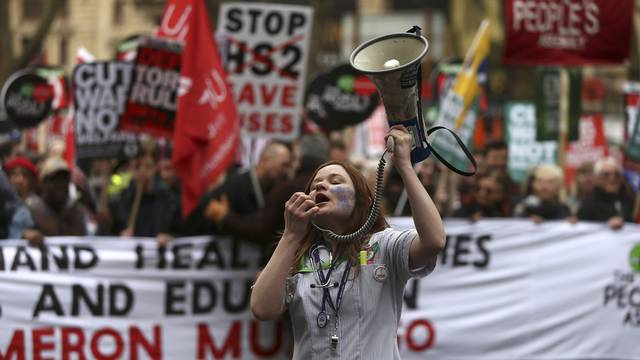 A demonstrator shouts through a megaphone during an anti-austerity protest in London