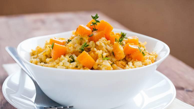 Vegetarijanski rižoto od tikve uz dodatak sira ribanca i vrhnja