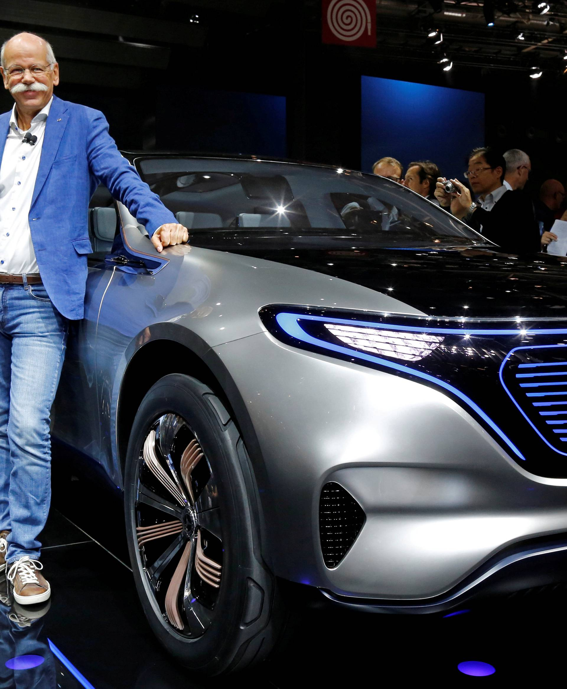 Dieter Zetsche, CEO of Daimler and Head of Mercedes-Benz, poses in front of a Mercedes EQ Electric car at the Paris auto show in Paris