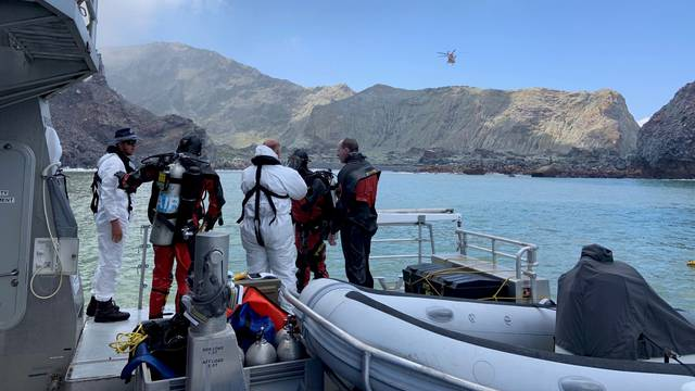 Members of a dive squad conduct a search during a recovery operation around White Island, which is also known by its Maori name of Whakaari, a volcanic island that fatally erupted earlier this week, in New Zealand