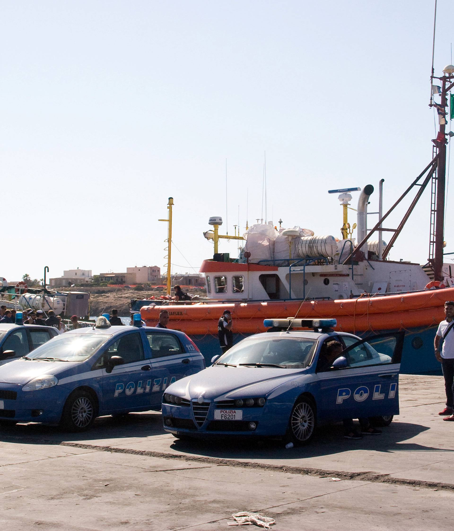 """Italian police stand around the German NGO Jugend Rettet ship """"Juventa"""" in Lampedusa harbour, Italy"""