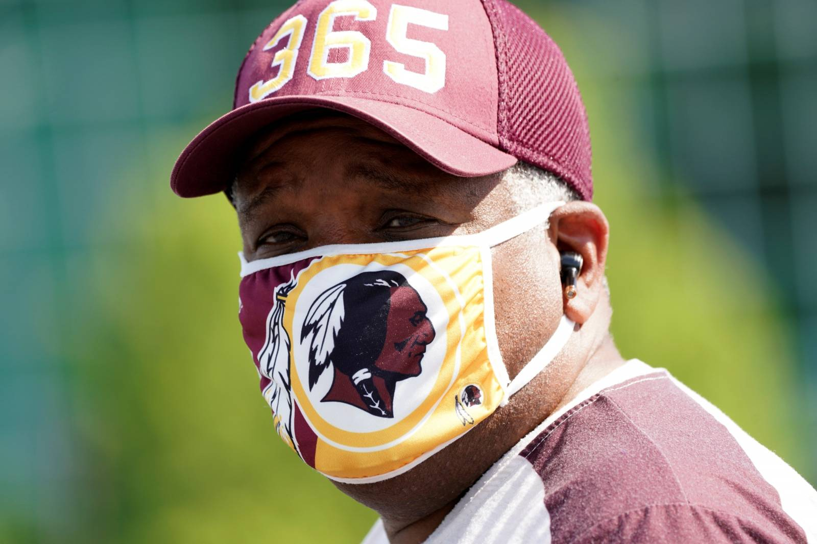 Man wears Washington Redskins-themed face mask at FedEx Field in Landover, Maryland