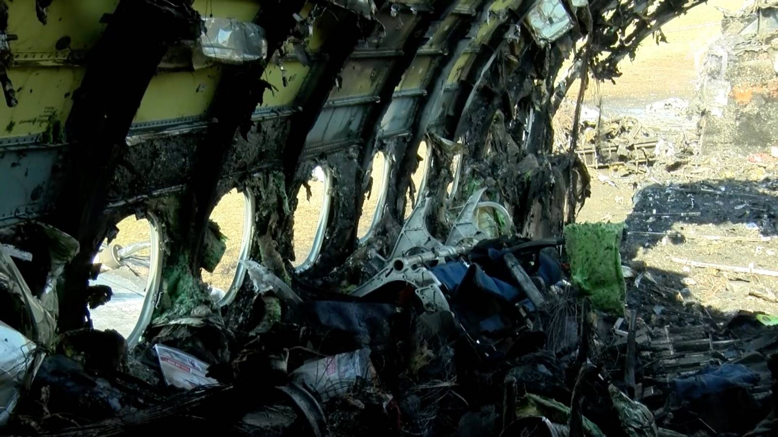 A still image shows a burnt-out Aeroflot Sukhoi Superjet 100 passenger plane at Moscow's Sheremetyevo airport