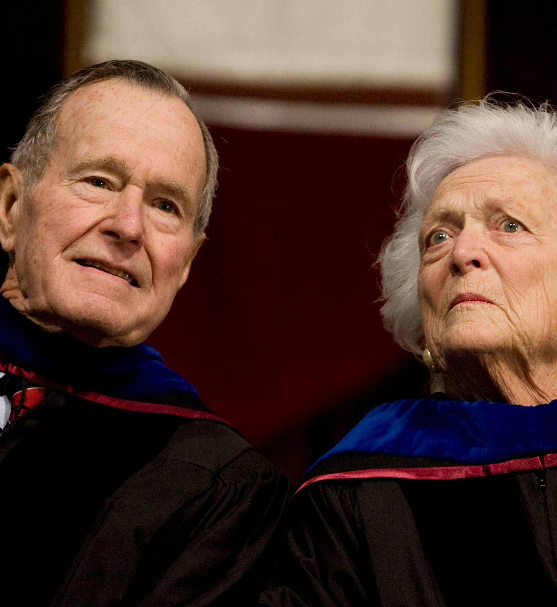 FILE PHOTO - Former President George H.W. Bush, and former first lady, Barbara Bush, attend the Texas A&M University commencement ceremony in College Station