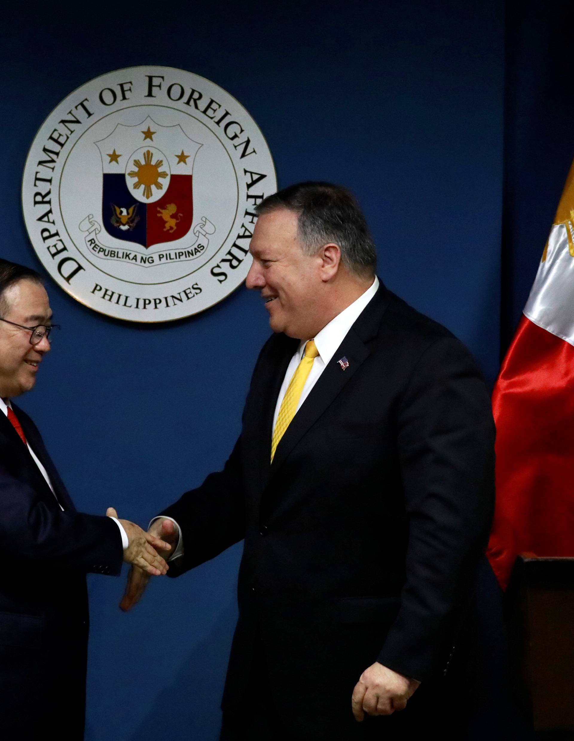 U.S. Secretary of State Mike Pompeo shakes hands with Philippine Foreign Secretary Teodoro Locsin Jr. at the Department of Foreign Affairs in Pasay City