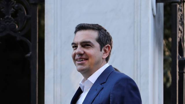 Greek PM Tsipras leaves the Presidential Palace following a meeting with Greek President Pavlopoulos to discuss snap elections in Athens