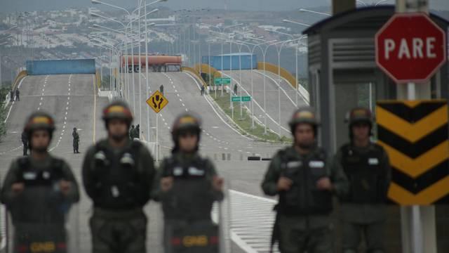 A fuel tank and cargo containers block the vehicular passage on Tienditas cross-border bridge between Colombia and Venezuela as seen from Tienditas