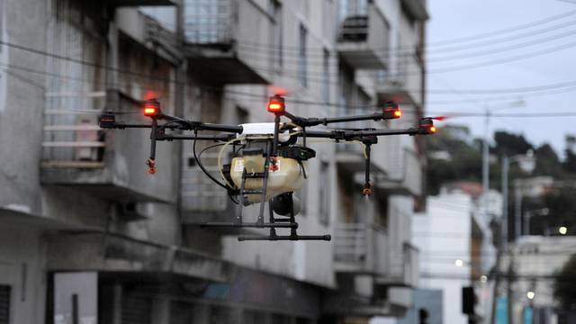A drone is used to release disinfectant on streets during the coronavirus disease (COVID-19) outbreak in Talcahuano
