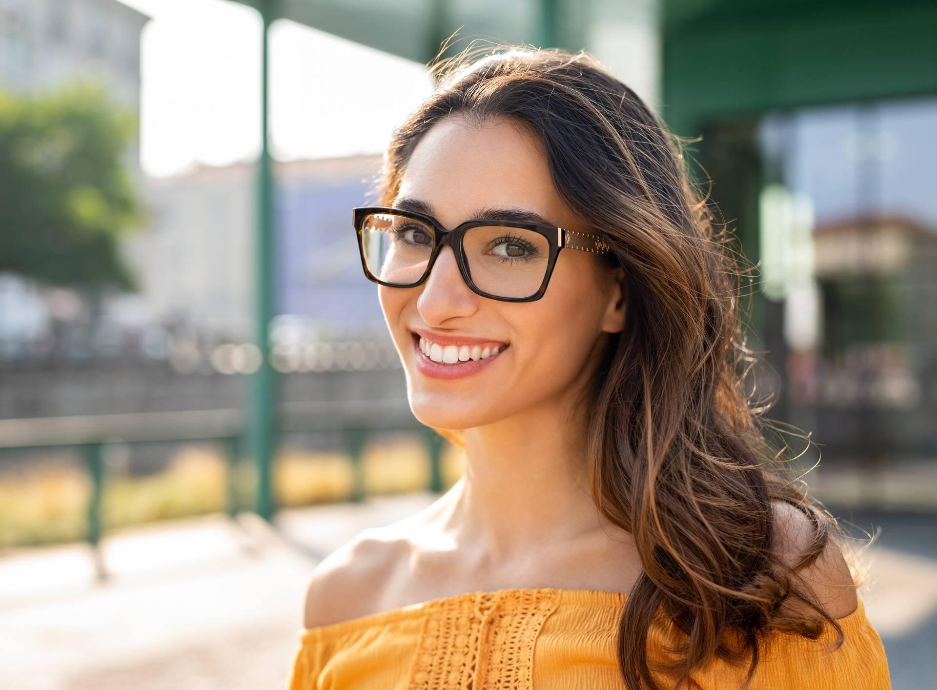 Smiling woman wearing eyeglasses outdoor