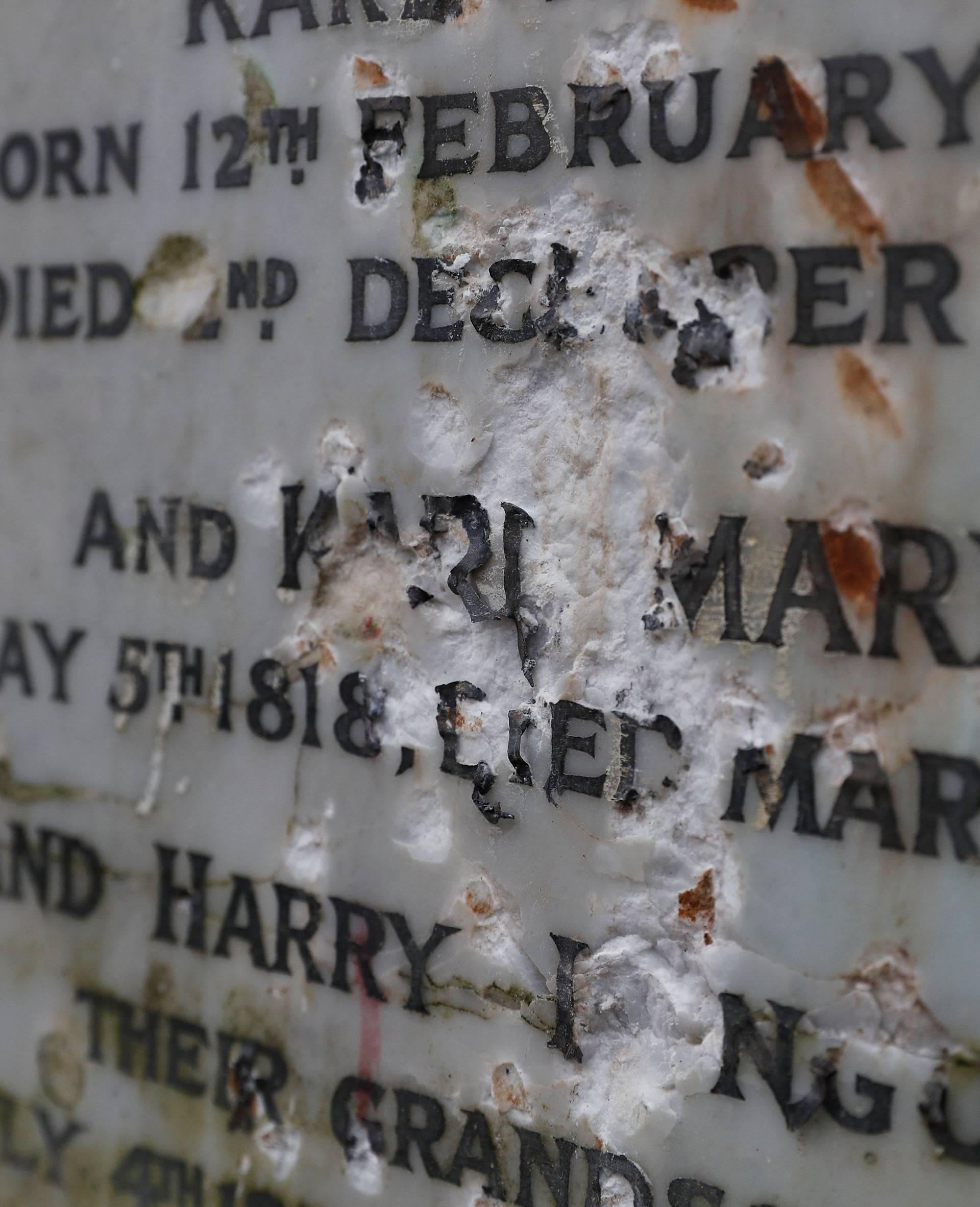 A memorial to German philosopher Karl Marx is seen after it was vandalised at Highgate Cemetery in north London
