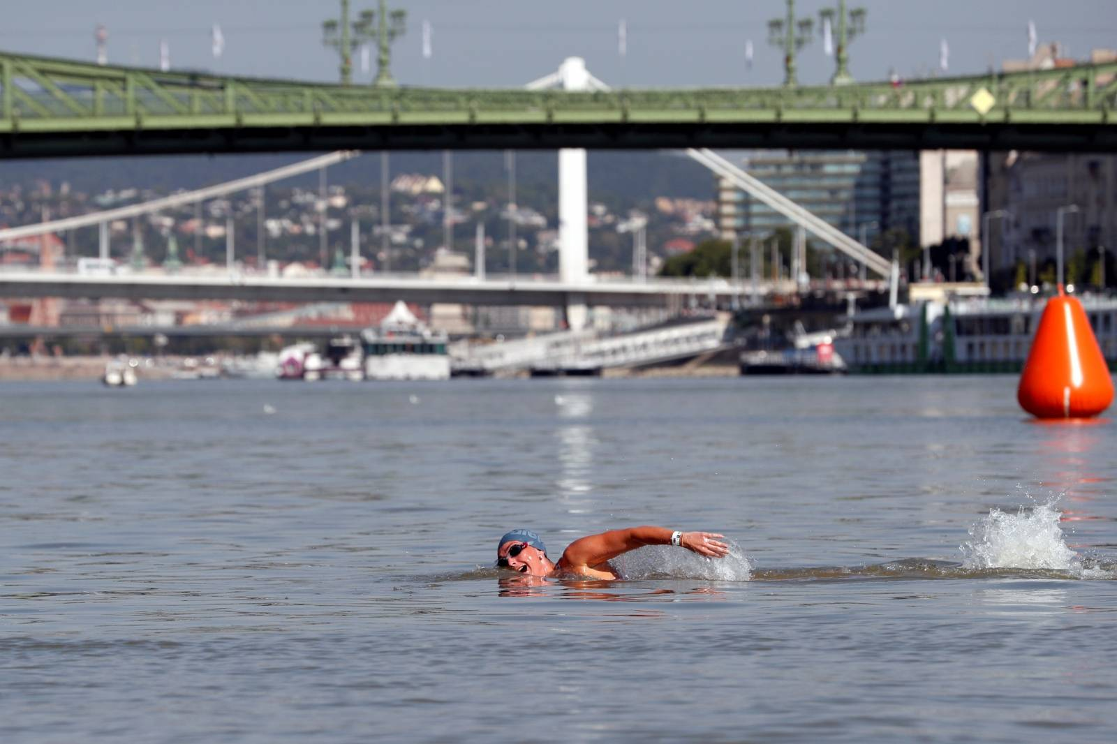 Participants swim across the Danube River during the Budapest Urban Games in Budapest