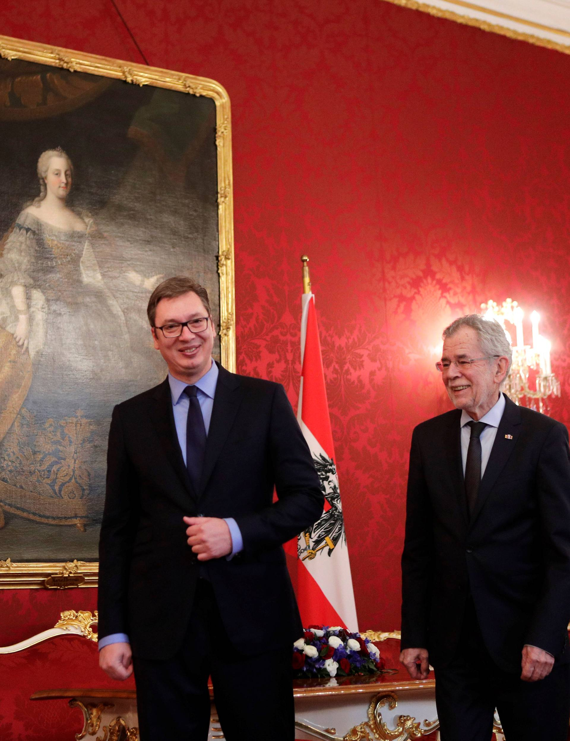 Serbia's President Vucic and Austria's President Van der Bellen walk by a portrait of former Empress Maria Theresa at the presidential office in Vienna