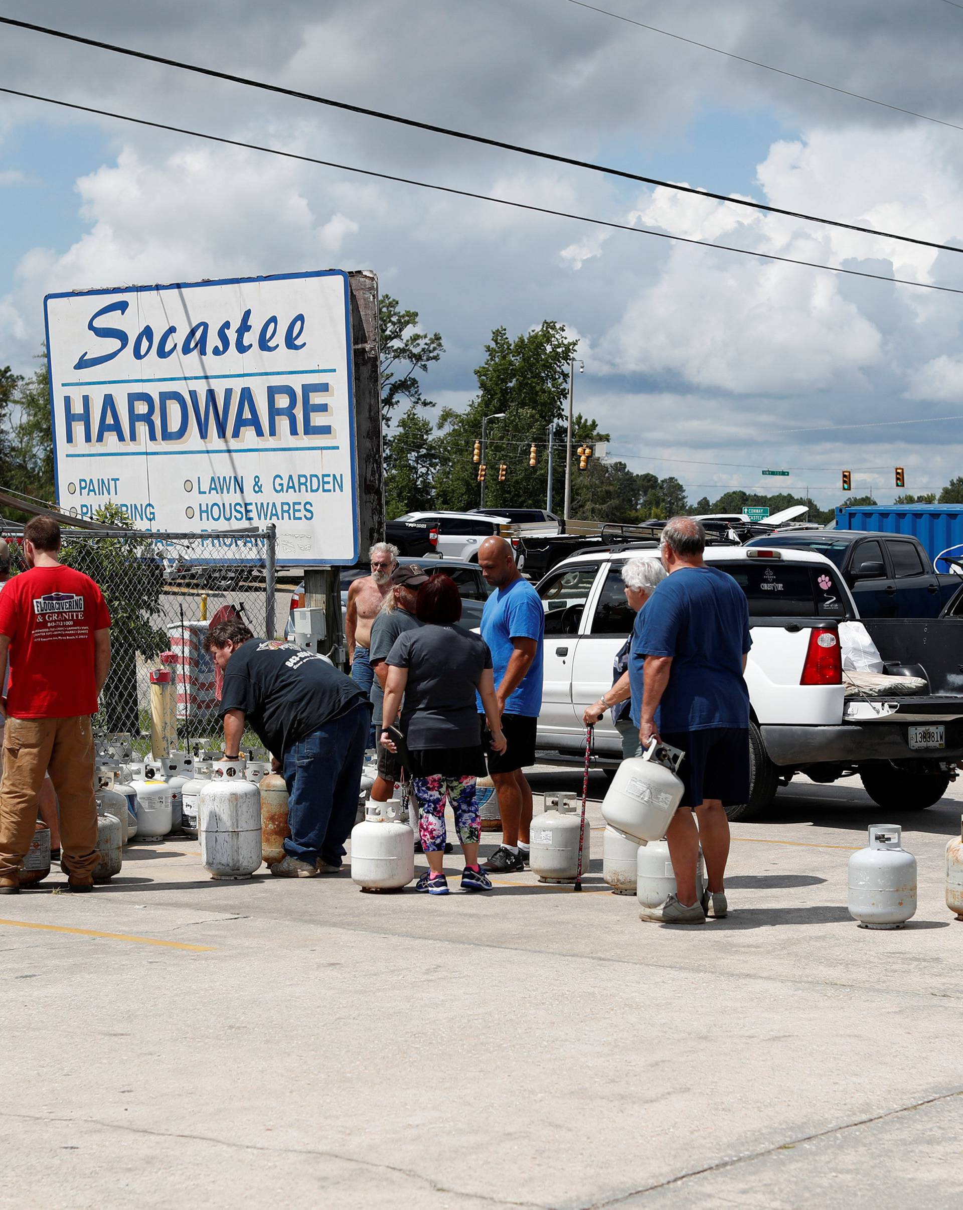Customers line up to buy propane at Socastee Hardware store, ahead of the arrival of Hurricane Florence in Myrtle Beach