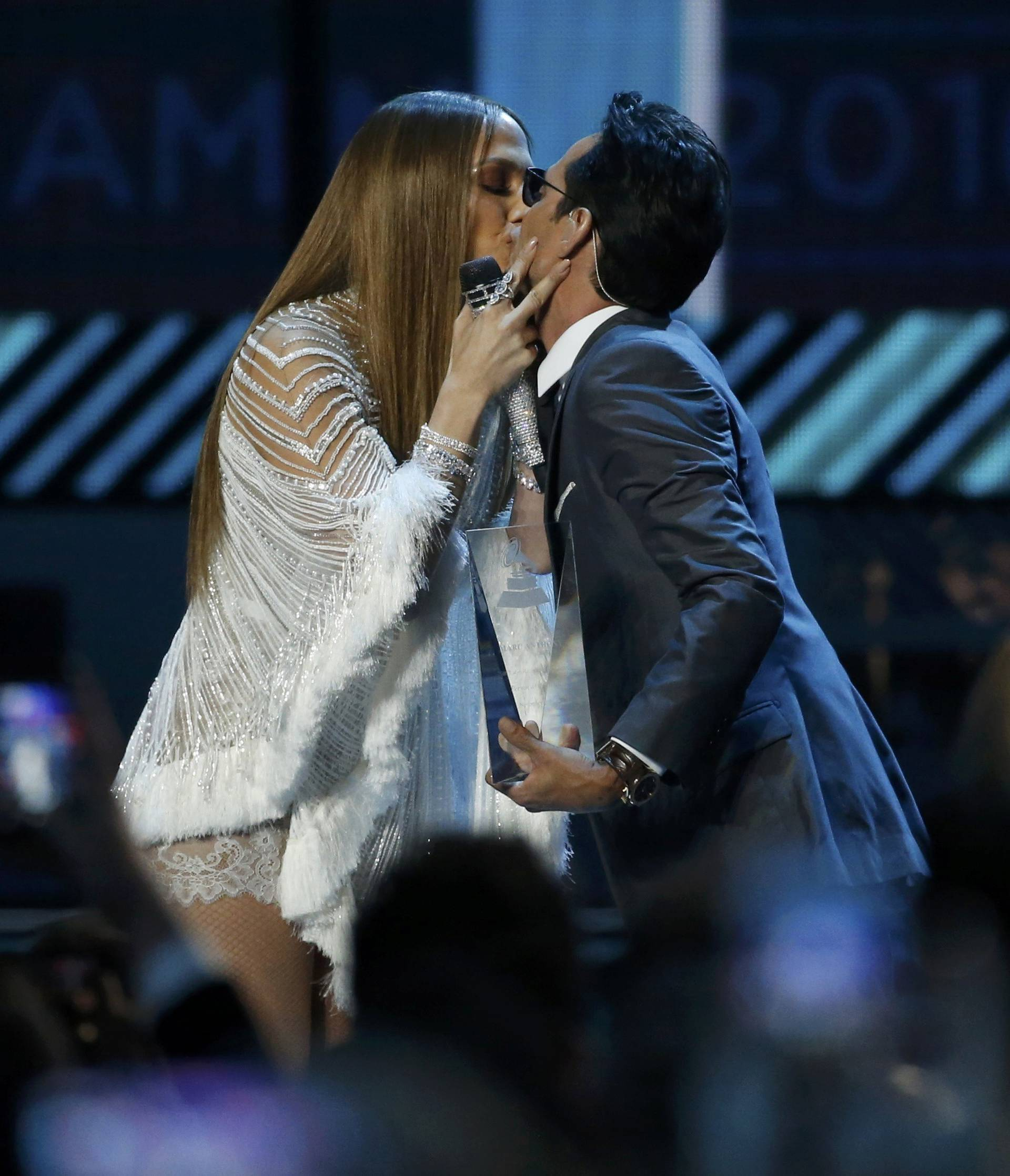 Lopez kisses Anthony after she presented him with award honoring him as Latin Recording Academy person of the year at the 17th Annual Latin Grammy Awards in Las Vegas