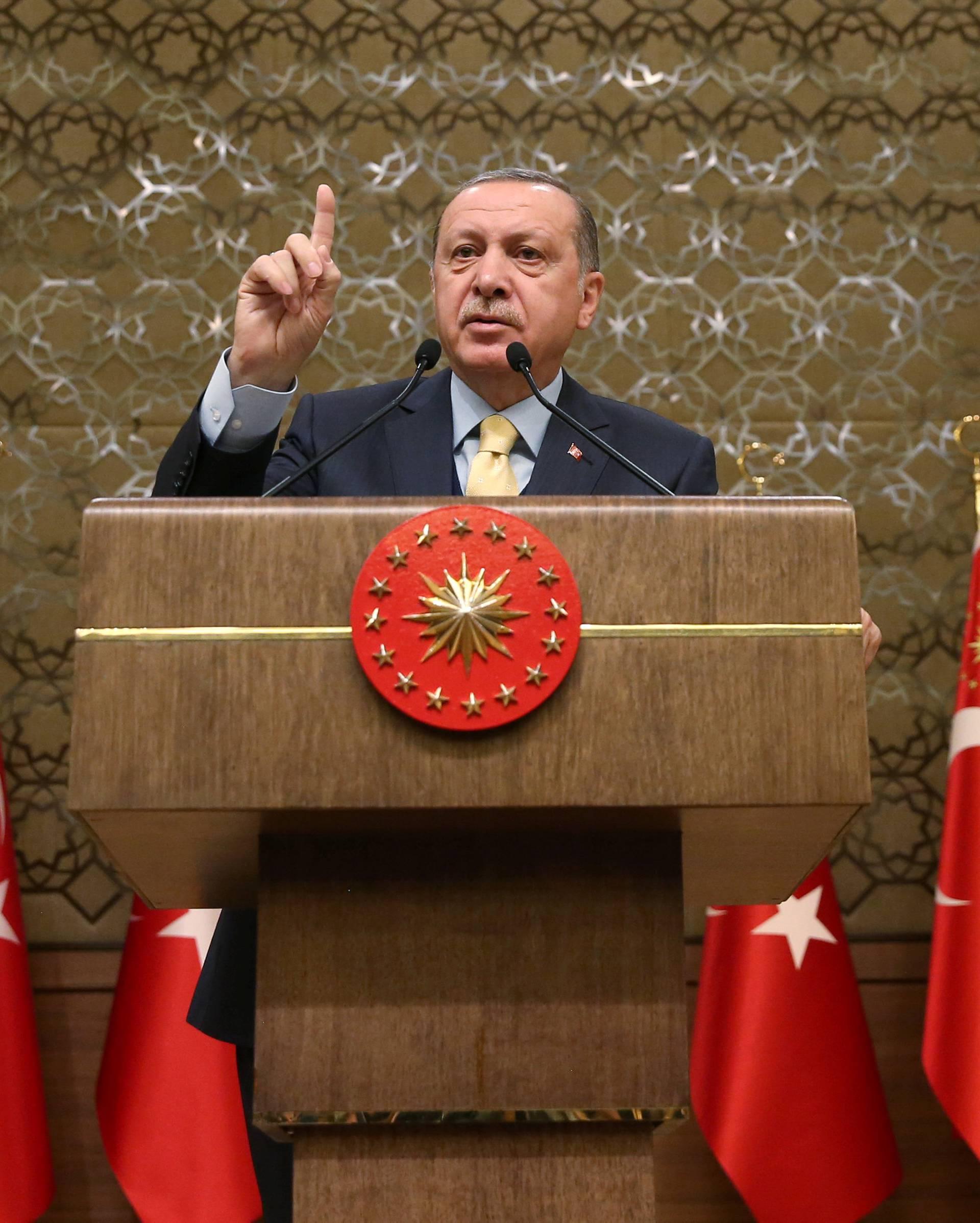 Turkish President Erdogan speaks during a meeting in Ankara