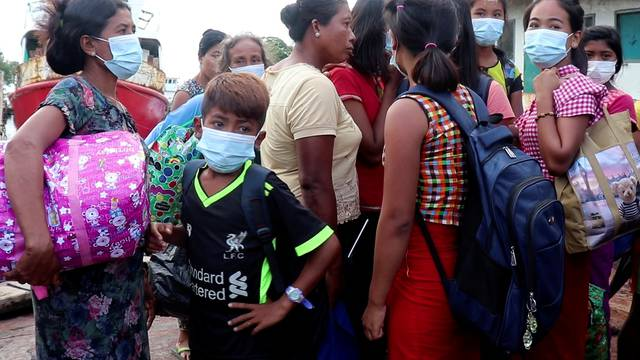 People who fled from Rathedaung Township arrive in Sittwe, the capital of Rakhine State