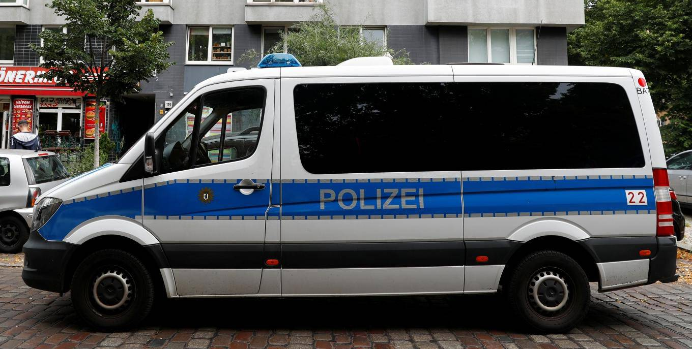 German police car is pictured during a raid in an apartment building at Kreuzberg district in Berlin