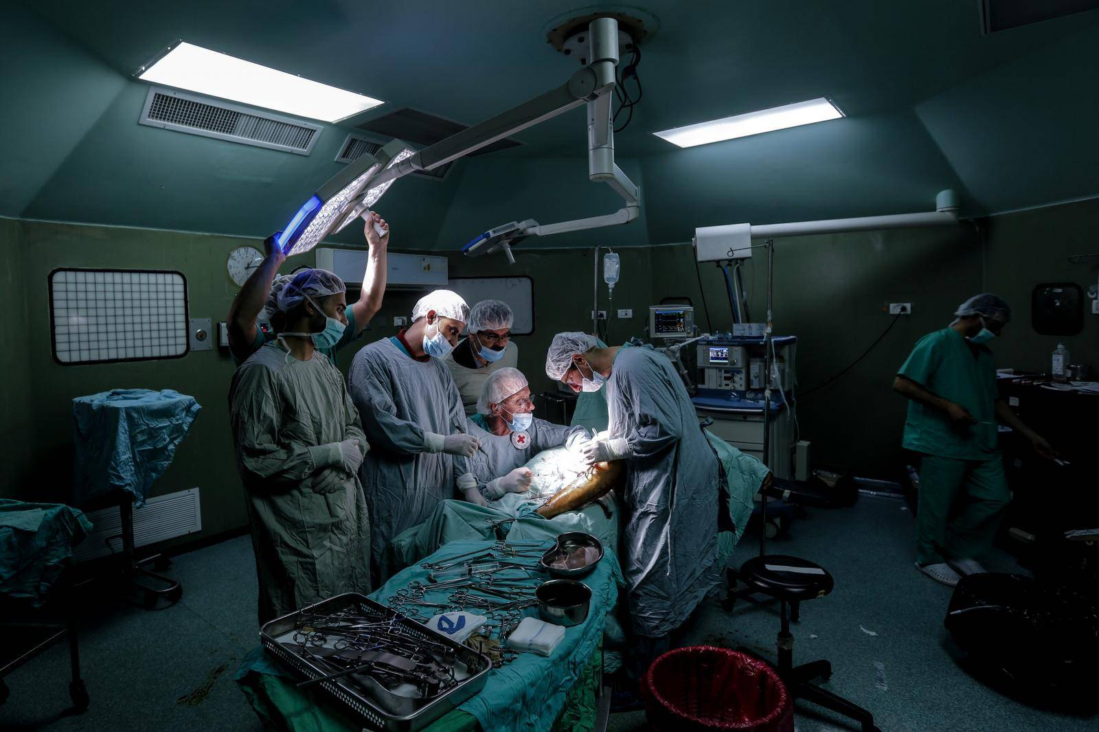 British vascular surgeon John Wolfe performs a surgery in Gaza