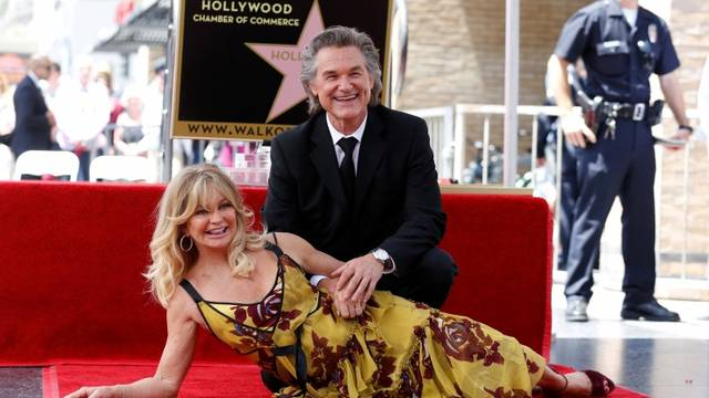 Actors Russell and Hawn pose after unveiling their stars on the Hollywood Walk of Fame in Los Angeles