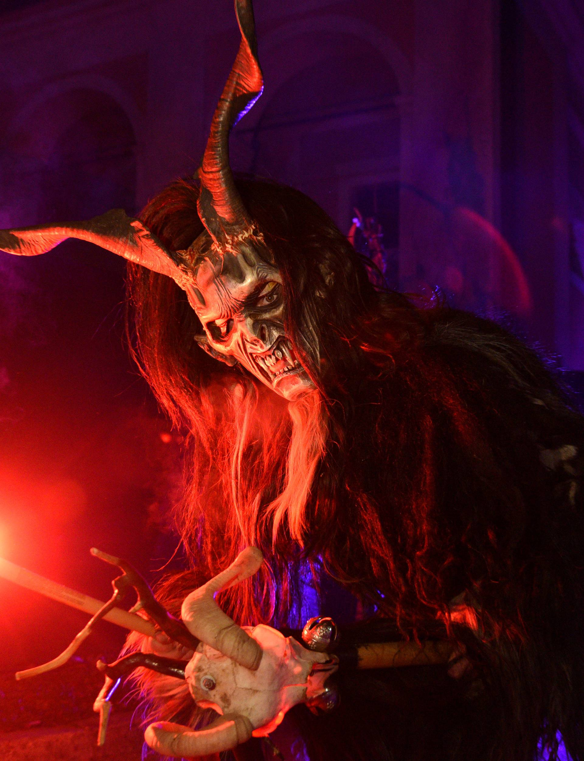 A man dressed as a devil performs during a Krampus show in Goricane