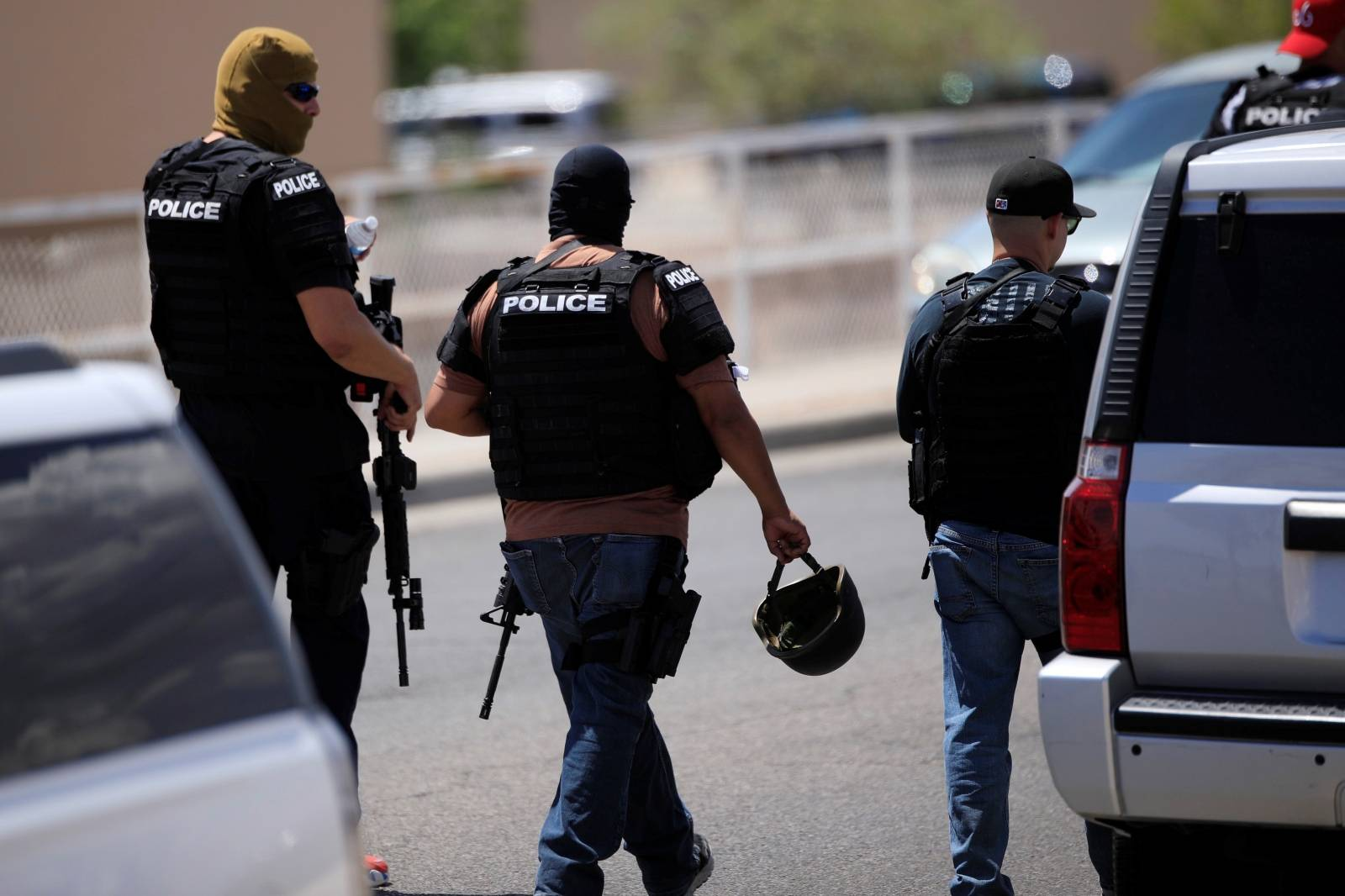 Police arrive after a mass shooting at a Walmart in El Paso
