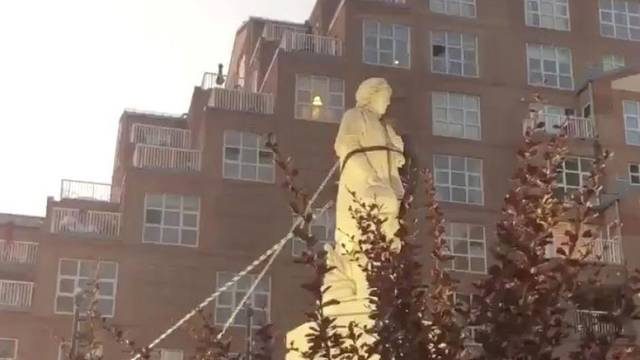 Protesters pull down the statue of Christopher Columbus in Baltimore