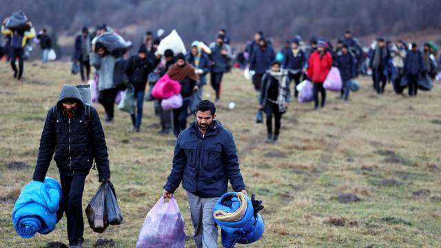 "Migrants walk towards the forest after camp ""Lipa"" was closed, in Bihac"