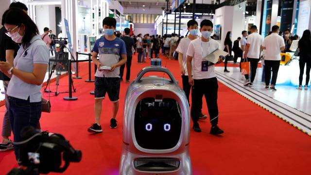 An autonomous delivery robot designed by Robint operates during the World Robot Conference 2021 in Beijing