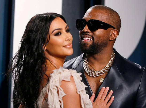 FILE PHOTO: Kim Kardashian and Kanye West attend a Vanity Fair Oscar party in Beverly Hills