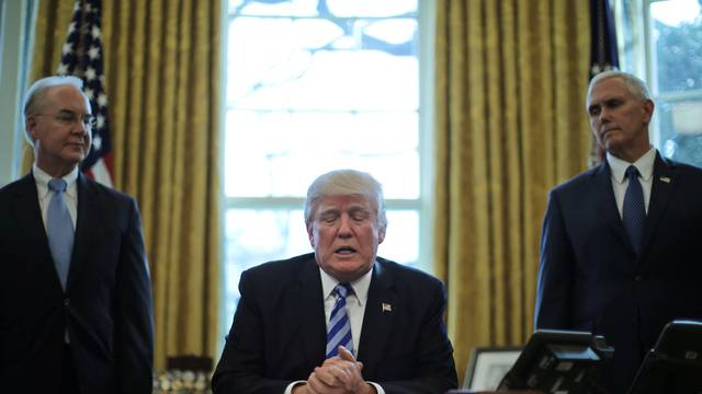 President Trump talks to journalists at the Oval Office of the White House after the AHCA health care bill was pulled before a vote, accompanied by U.S. Health and Human Services Secretary Tom Price and Vice President Mike Pence, in Washington