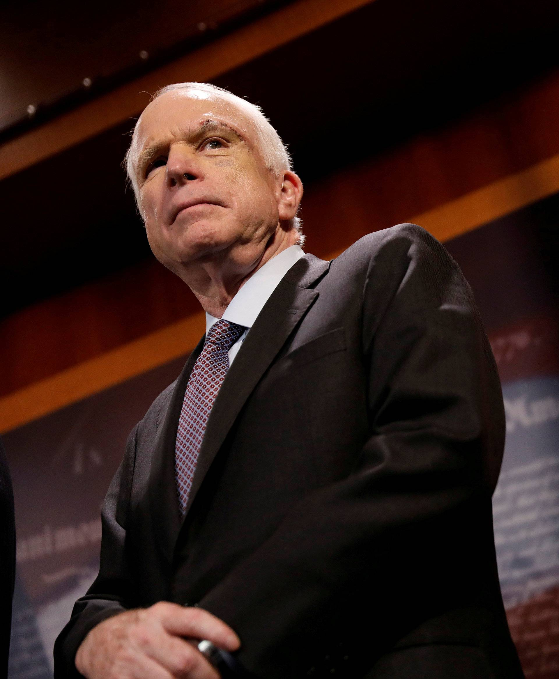 "FILE PHOTO:    Senator John McCain (R-AZ) looks on during a press conference about his resistance to the so-called ""Skinny Repeal"" of the Affordable Care Act on Capitol Hill in Washington"