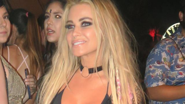 Carmen Electra leaves little to the imagination in a sheer outfit at Coachella