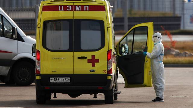 A medical specialist stands next to an ambulance outside a hospital for patients infected with coronavirus disease in Moscow