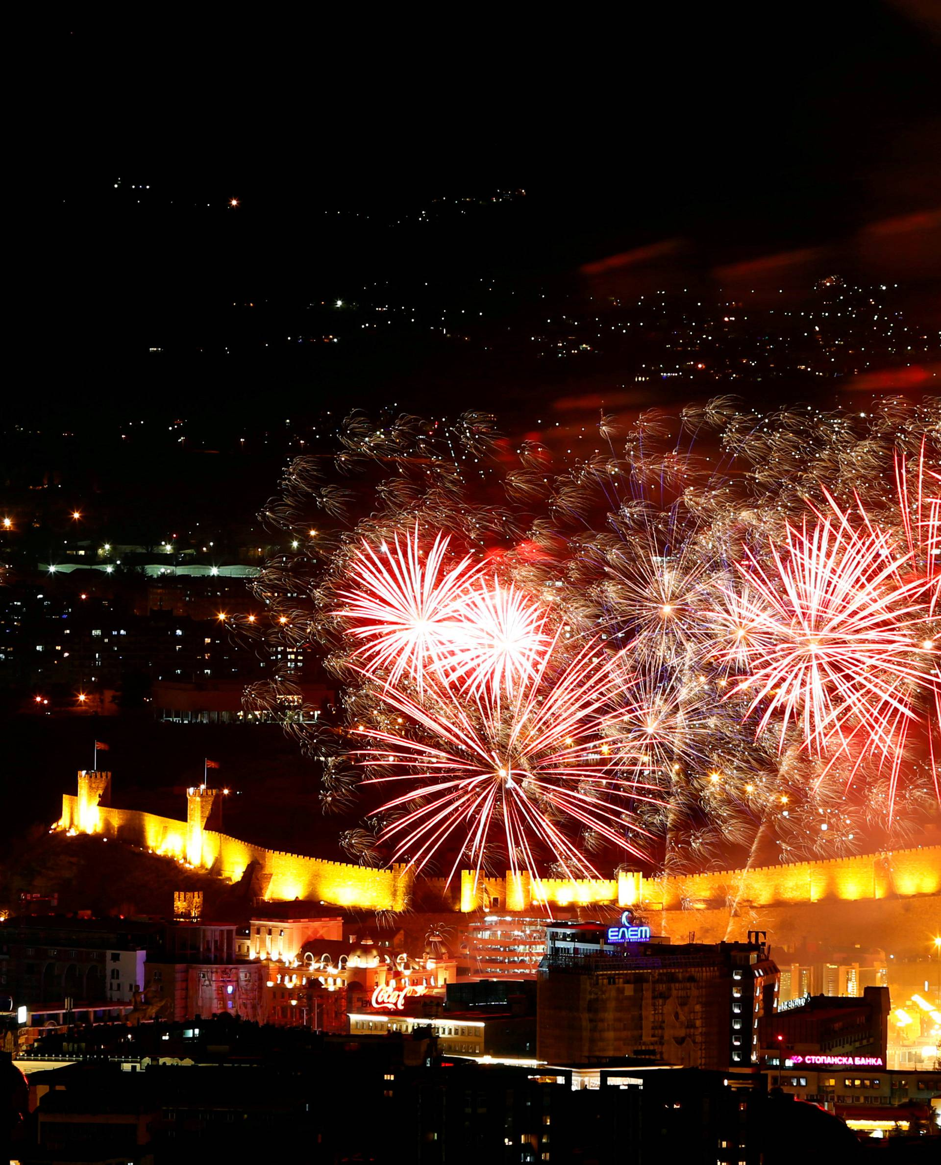 Fireworks explode over Skopje during the New Year celebrations