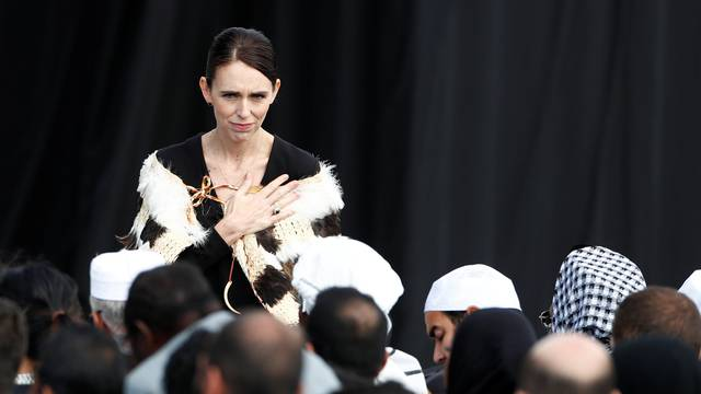 New Zealand's Prime Minister Jacinda Arden gestures to relatives of victims of the mosque attacks during the national remembrance service in Christchurch