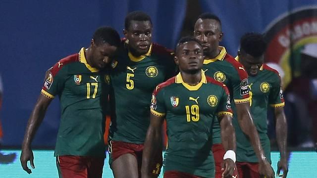 Cameroon's Michael Ngadeu-Ngadjui celebrates scoring their first goal with teammates