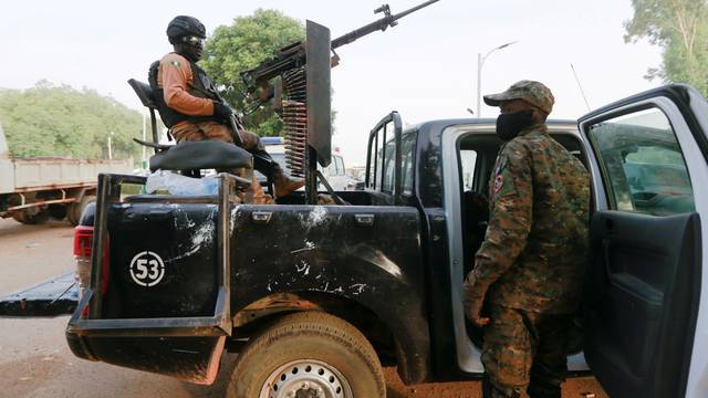 FILE PHOTO: A soldier sits on one of the trucks used to bring back the girls who were kidnapped from a boarding school in the northwest Nigerian state of Zamfara, following their release in Zamfara, Nigeria, March 2, 2021